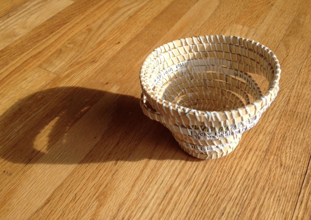 This coiled basket is made from discarded materials. I collect picture books and paper, also objects from nature to repurpose into artist books, journals and baskets.