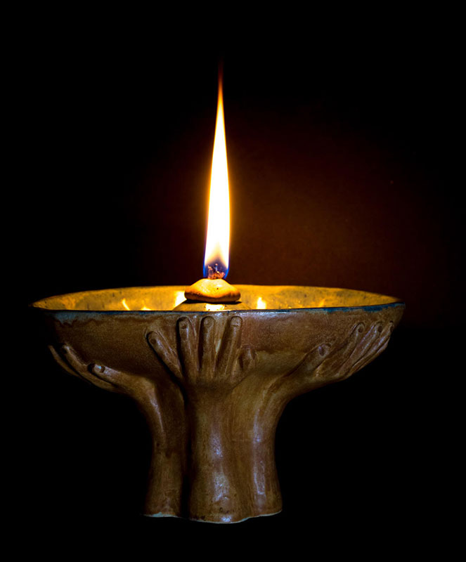Light has always signified the presence of the holy.  But, really, it could be just two people holding hands. Ken Stewart