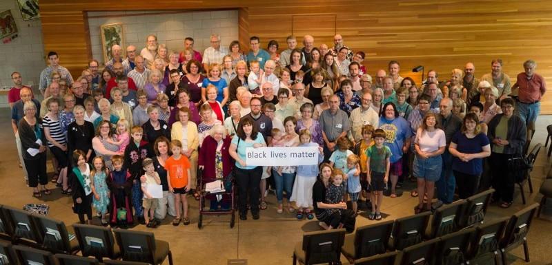Group shot of WBUUC congregation and Black Lives Matter sign