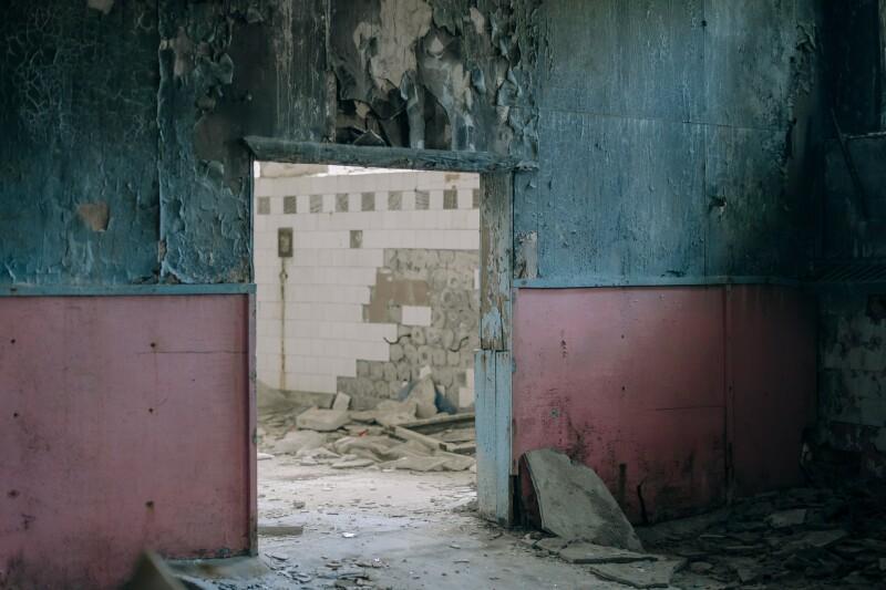 Photo of a doorway in ruins