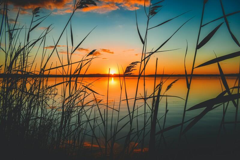 Photo of lake at sunset